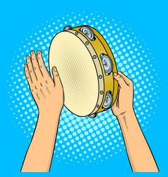 hands with tambourine pop art vector image