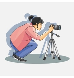 Young female photographer photographing vector
