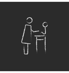 Woman taking care of the baby icon drawn in chalk vector