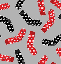 Black and red socks with skull seamless pattern vector