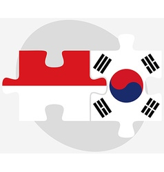 Indonesia and south korea flags in puzzle vector