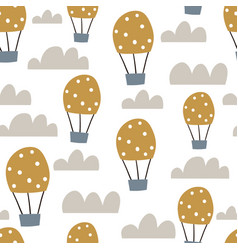 Childish seamless pattern with hot air ballon in vector