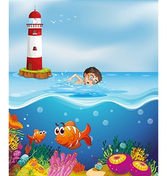 A boy swimming at the beach with a lighthouse vector