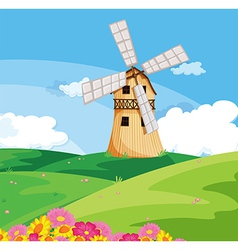 A windmill above the hill vector