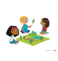 Children sitting on floor explore toy landscape vector