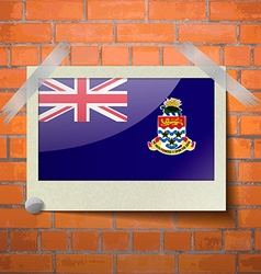 Flags cayman islands scotch taped to a red brick vector