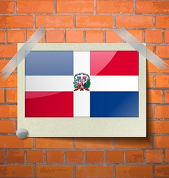 Flags dominican republic scotch taped to a red vector