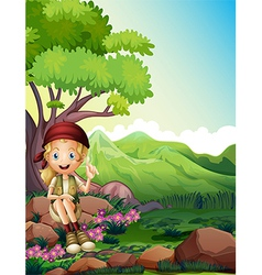 A girl resting above the rocks in the forest vector