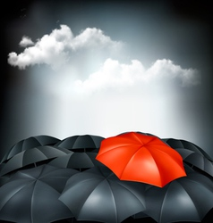 One red umbrella in a group of grey umbrellas vector