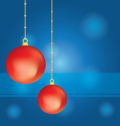 Red Christmas balls on abstract blue background vector image