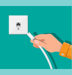 rj45 lan cable in hand and network socket vector image