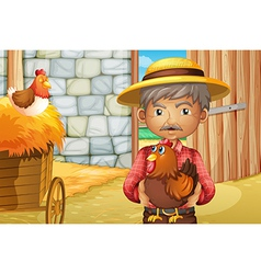 An old man holding a rooster inside the barnhouse vector image