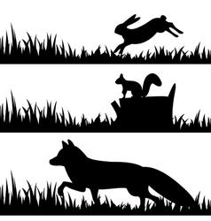 Set silhouettes of animals in the grass vector