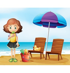 A girl eating an icecream at the beach vector image