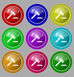 Judge hammer icon symbol on nine round colourful vector
