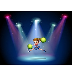 A cheerleader jumping on the stage with spotlights vector