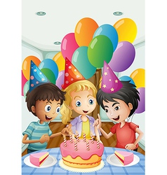 Three kids celebrating a birthday vector image
