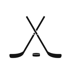 Crossed hockey sticks and puck icon simple style vector image