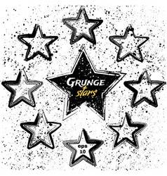 set of black grunge stars vector image