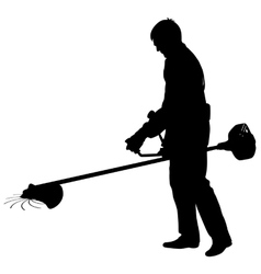 Silhouette worker of a garden cuts off grass vector