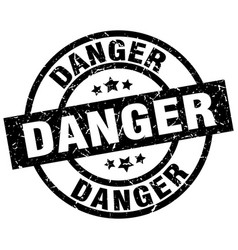 Danger round grunge black stamp vector