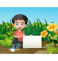 A smiling boy holding an empty signage in the vector image vector image