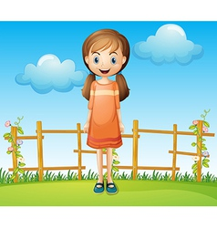 A little woman standing near the wooden fence vector image