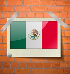 Flags Mexico scotch taped to a red brick wall vector image