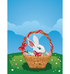 Easter bunny with eggs in the basket vector