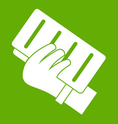 brick in a hand icon green vector image