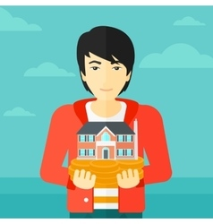 Man holding house model vector