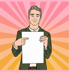 Pop art businessman pointing at blank paper sheet vector