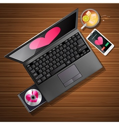 Heart shape on laptop screen and mobile phone vector