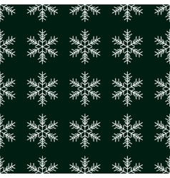 Seamless pattern with snowflakes on green vector