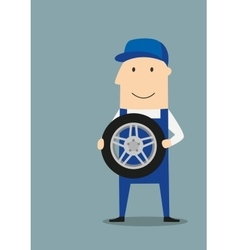 Happy car mechanic with wheel vector image