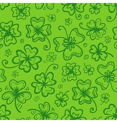Green hand drawn clovers seamless pattern vector image