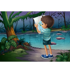 A boy with a map standing in the middle of the vector image vector image