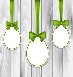 Easter three papers eggs wrapping green bows on vector