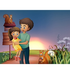 A father carrying his daughter at the hilltop vector image