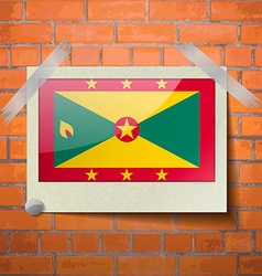Flags grenada scotch taped to a red brick wall vector