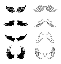 Set of wings - silhouette design elements vector image