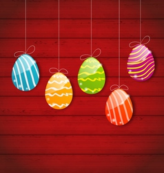 Easter three ornamental colorful eggs on wooden vector
