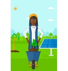 Woman with plant and wheelbarrow vector
