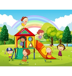 Children playing at the playground in the park vector image vector image