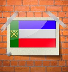 Flags khakassia scotch taped to a red brick wall vector