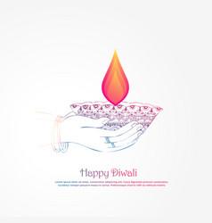 Hand holding burning diya diwali festival vector