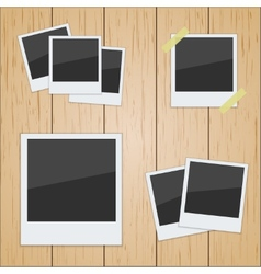 Set of pictures on a wooden texture vector image