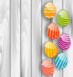 Easter glossy colorful eggs on grey wooden texture vector