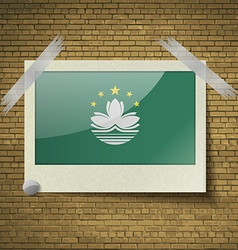 Flags Macau at frame on a brick background vector image