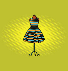 Striped dress in studio on the dummy front hanger vector